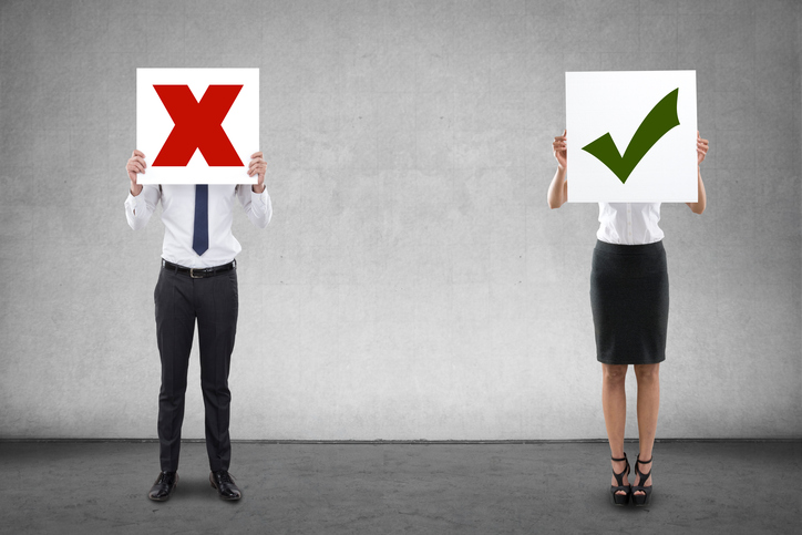 Business people holding tick and cross sign icon placards, decision making concept